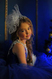 Young princess in a blue evening dress Stock Photography