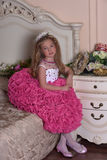 Young princess in an elegant pink dress sitting Royalty Free Stock Photos
