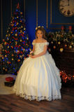 Young princess in an elegant white dress. In Christmas Royalty Free Stock Photo