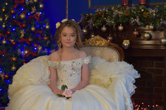 Young princess in an elegant white dress. In Christmas Royalty Free Stock Photography