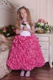 Young princess  among the flowers Stock Photo