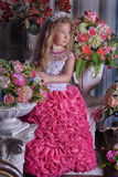 Young princess  among the flowers Royalty Free Stock Photos