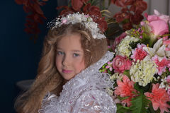 Young princess  among the flowers Stock Photography