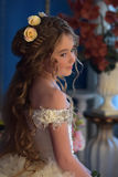 Young princess with long hair and flowers in her hair