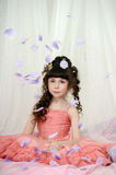 Young princess with pink dress with rose petals Royalty Free Stock Photography