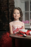 A young princess in a red evening dress Royalty Free Stock Photography