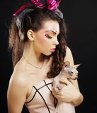 Young princess with Sphynx cat. Royalty Free Stock Image