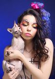 Young princess with Sphynx cat. Royalty Free Stock Photos