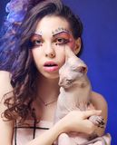 Young princess with Sphynx cat. Stock Photography