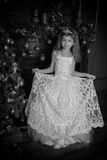 Young princess in a white dress with a tiara on her head , Vintage black and white photo Stock Image