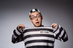 Young prisoner against gray Stock Photo