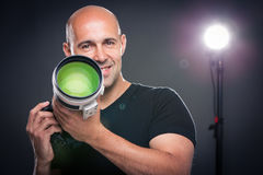 Young, pro male photographer in his studio during a photo shoot Royalty Free Stock Images