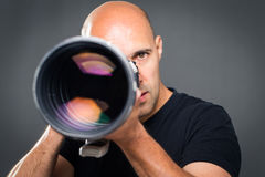 Young, pro male photographer in his studio Stock Images