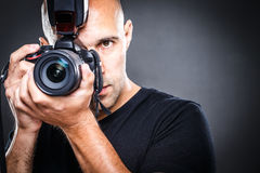 Young, pro male photographer in his studio during a photo shoot stock image