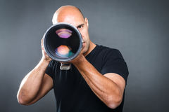 Young, pro male photographer in his studio Royalty Free Stock Image
