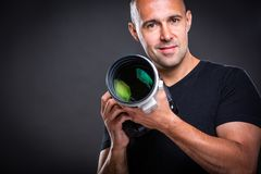 Young, pro male photographer in his studio during a photo shoot stock images