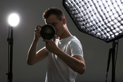 Young pro photographer with digital camera - DSLR Stock Image