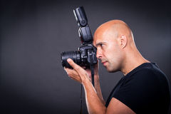 Young pro photographer with digital camera Stock Photography