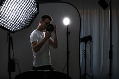 Young pro photographer with digital camera Stock Photo