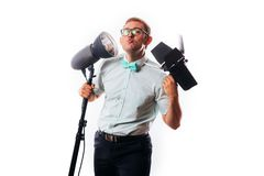 Photographer in his studio setting up lights for the upcoming photoshoot royalty free stock photo