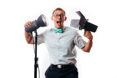 Photographer in his studio setting up lights for the upcoming photoshoot royalty free stock images