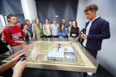 Young producer Ilya Bachurin shows layout of new cinema Stock Photo