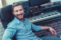 Young producer. Smiling producer in recording studio royalty free stock image