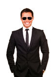 Young professional. Smiling with sunglasses on a white background royalty free stock photography