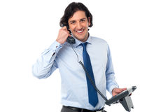 Young professional answering phone call Royalty Free Stock Photography