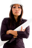 Young professional asian woman. Wearing helmet and holding blue prints Royalty Free Stock Photo