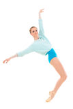 Young professional ballerina on tiptoe. Young professional ballerina with long legs on tiptoe doing exercises isolated on white background Royalty Free Stock Images