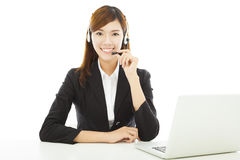 Young professional business woman with earphone and laptop royalty free stock images