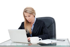 Young professional business woman working at desk Royalty Free Stock Image