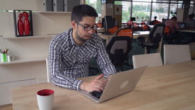Young professional businessman working at the modern creative office. stock video footage