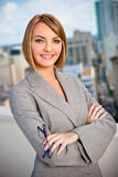 Young Professional Businesswoman in City. A young smiling businesswoman in a downtown setting Stock Photo