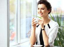 Young professional businesswoman sitting at cafe Royalty Free Stock Photo