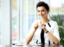 Young professional businesswoman sitting at cafe Stock Photography