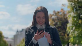 Young professional businesswoman walking on city streets, sunshine, slow motion. stock video footage