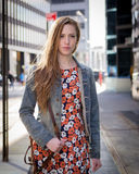 Young professional Caucasian woman walking on city street Stock Photo