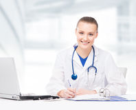 Young, professional and cheerful female doctor Royalty Free Stock Image