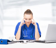 Young, professional and cheerful female doctor Stock Photo