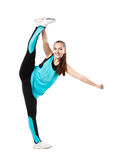 Young professional cheerleader  stands in vertical splits. Royalty Free Stock Photo