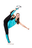 Young professional cheerleader  stands in vertical splits. Royalty Free Stock Image