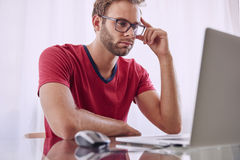 Young professional concentrating at work Royalty Free Stock Photography