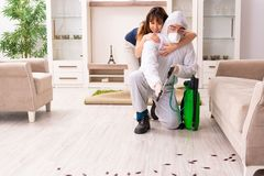 The young professional contractor doing pest control at flat royalty free stock images