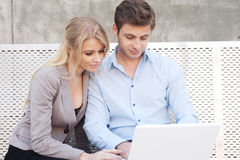 Young professional couple on laptop Royalty Free Stock Photography