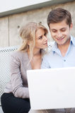 Young professional couple on laptop Stock Image