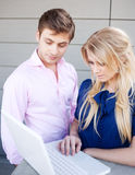 Young professional couple using laptop Royalty Free Stock Photography