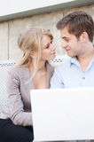 Young professional couple using laptop Royalty Free Stock Image