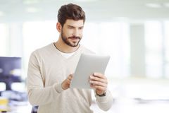 Young professional with digital tablet Royalty Free Stock Image